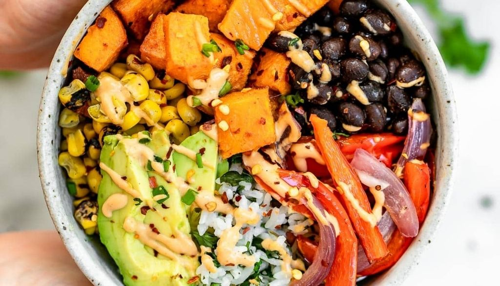 Vegan sweet potato and black bean burrito bowl recipe.